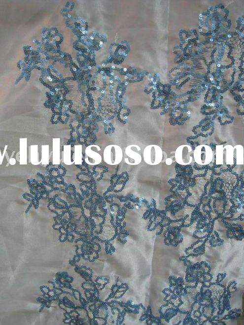 Embroidered decorator fabric patterns for drapery and upholstery.