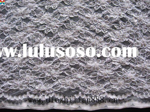 white lace fabric with beads