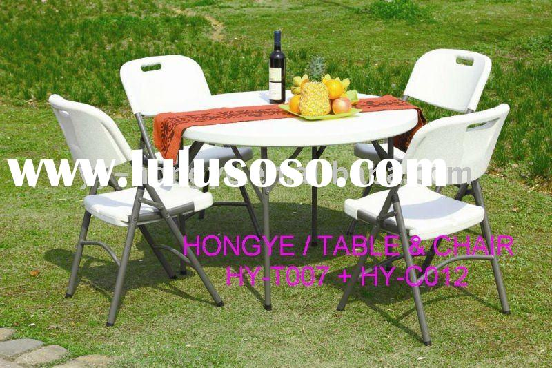 white plastic round folding table and folding chair