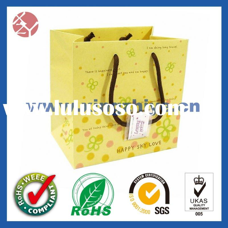 Yellow paper bag with ribbon handle