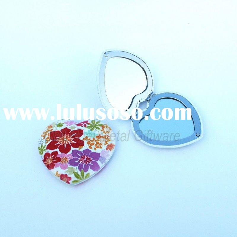 Elegant compact mirror with 4C printed on the top