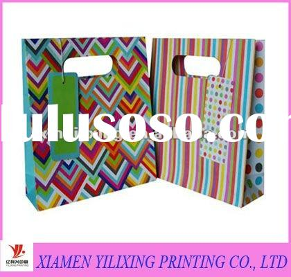 Holiday gift paper bag with diecut handle