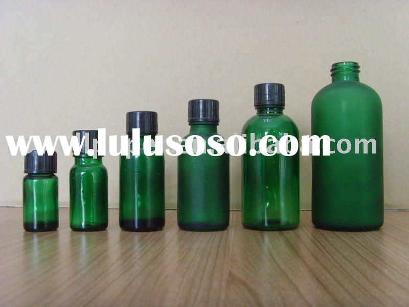 green essential oil bottle