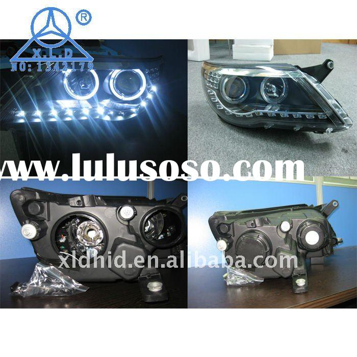 OEM Volkswagen Tiguan headlight assembly with angel eye and projector lens