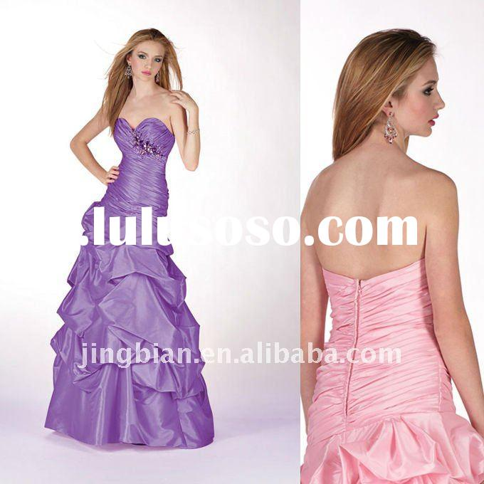 Simple yet beautiful prom Dress with pleated bodice and pick-up skirt. Mixed colorful hand beaded em