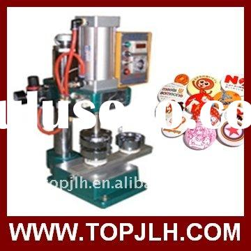 A badge/button making machine, button pin machine,badge machine