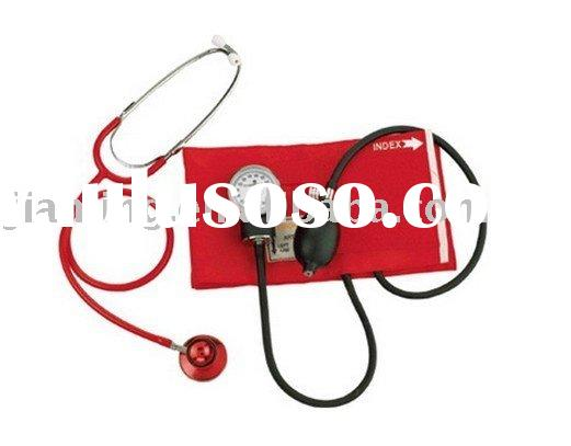 Blood pressure monitor with dual head stethoscope