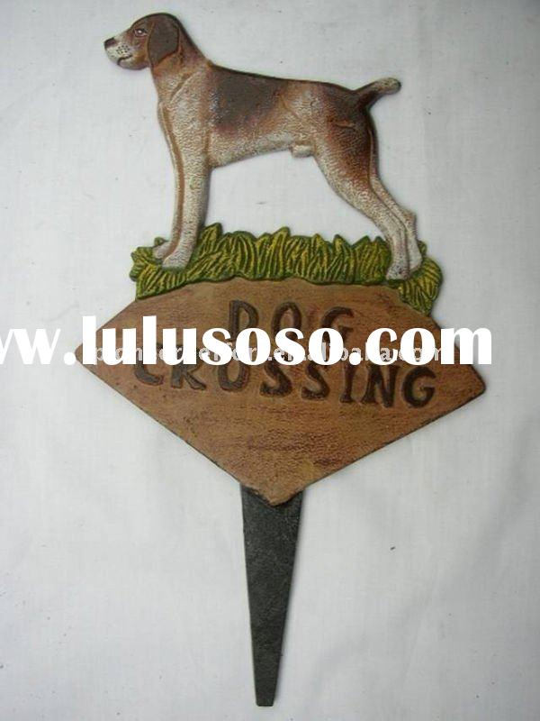 Metal / cast iron garden stake decoration, dog with sign