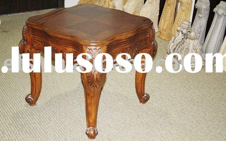 antique wood table with hand carvings