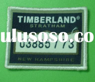 label, logo, trademark, hang tag, tag, scutcheon, jeans leather label