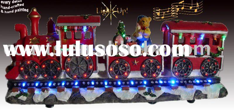 "16"" Christmas Train carrying happy children with rotating LED wheels"
