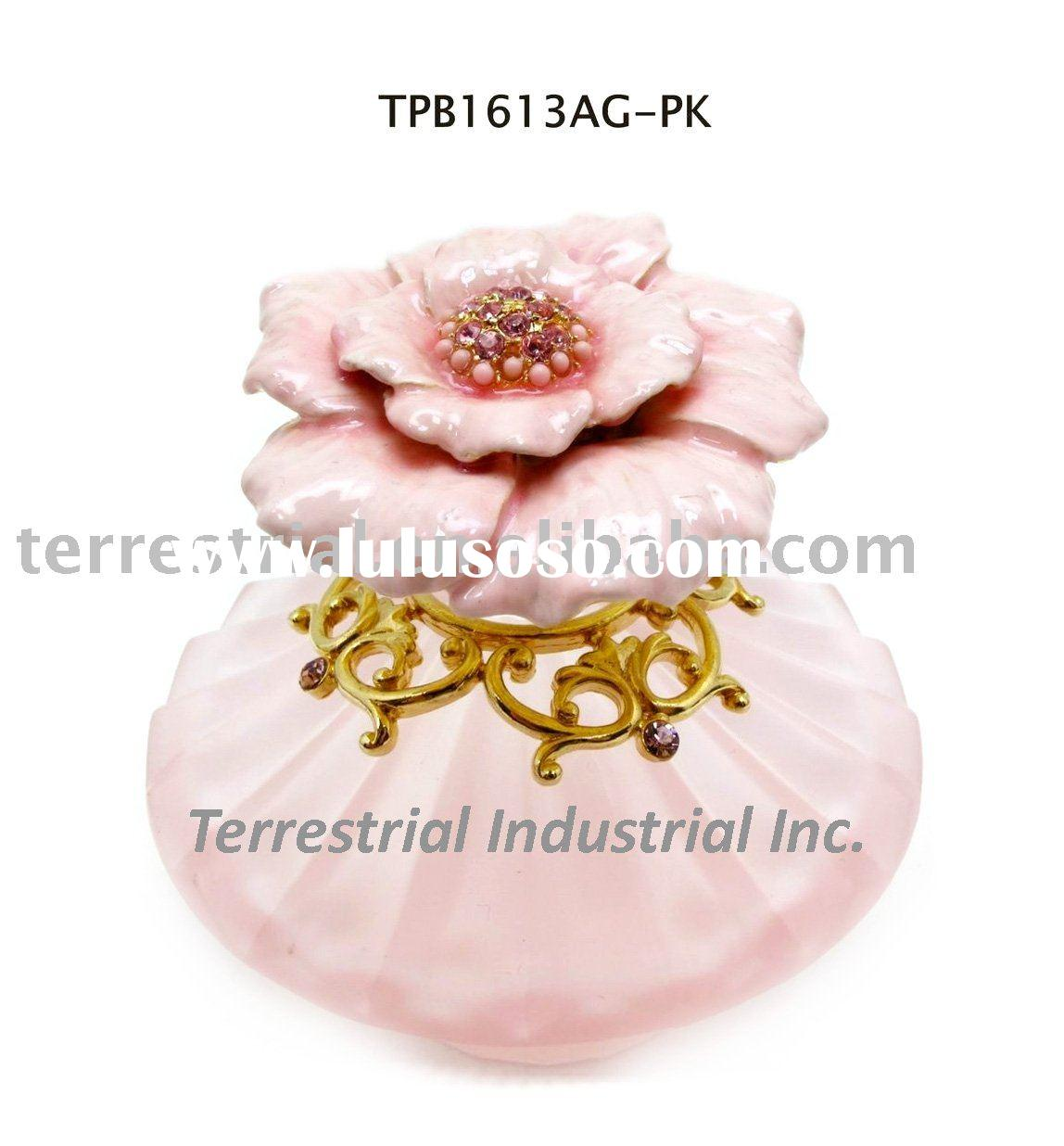 Glass perfume bottle with camellia decor