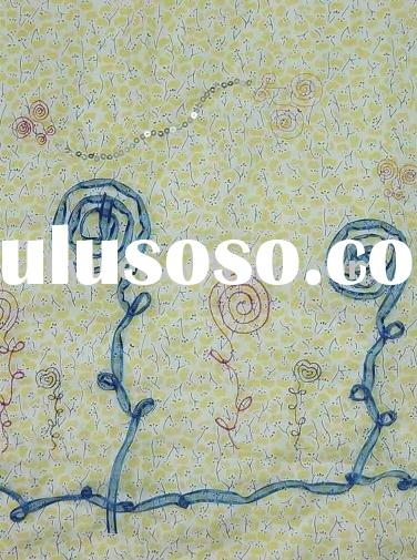 embroidered fabric with blue ribbon embroidery and yellow printing