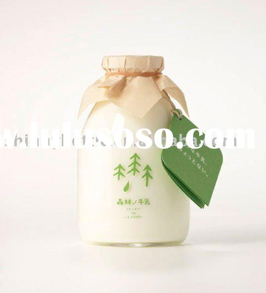 empty druable clear milk glass bottles with cap