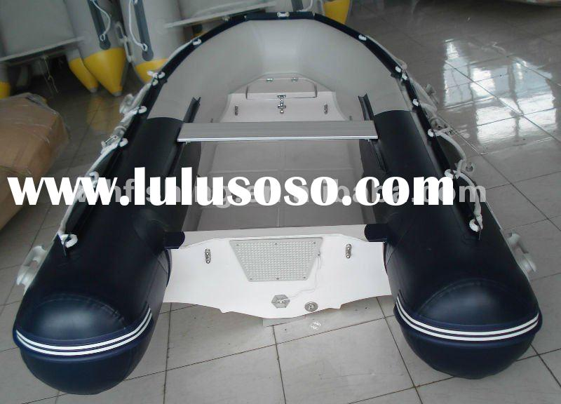 inflatable small RIB boat with fiberglass hull console and steering wheel