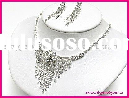 Rhinestone flower and triangle drop necklace and earring set