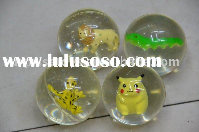 rubber bouncing ball with a figure inside for kids