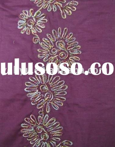 embroidery fabrics decorated with coiled circle cord embroidery patterns