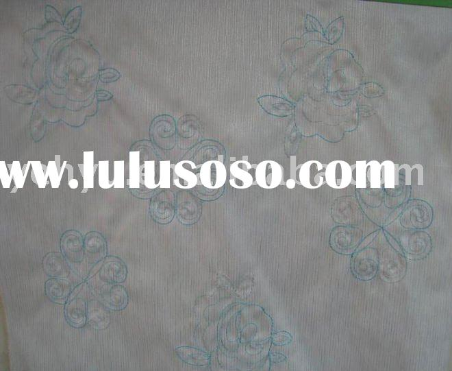 white embroidery fabric with blue flower outline embroidery