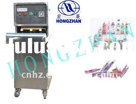 Plastic bag filling and sealing machine