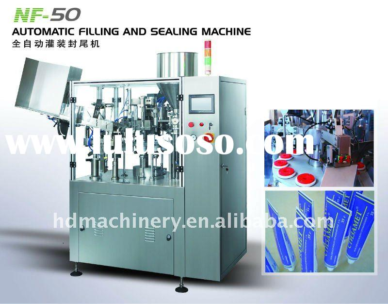 Automatic tube filling and packing machine