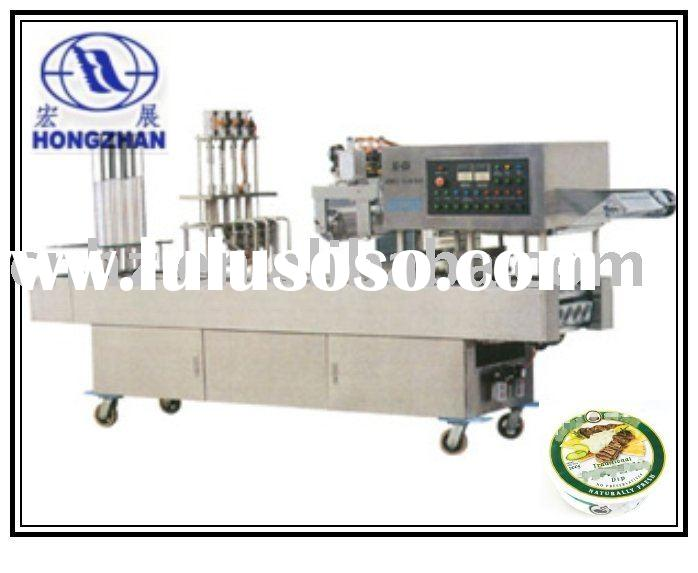 Automatic cream, butter cup filling and sealing machine