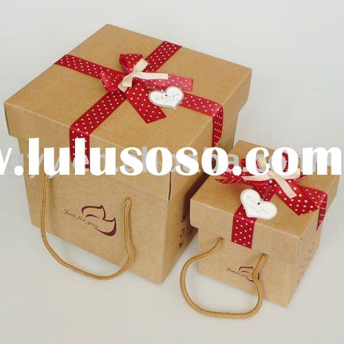 Brown kraft cardboard packaging box with handle and ribbo bow
