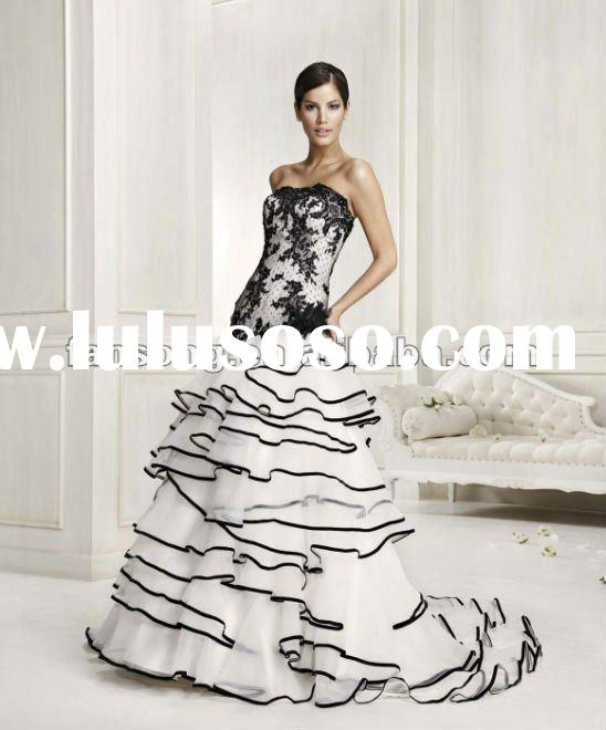 Gorgeous strapless mermaid black and white lace corset wedding dress