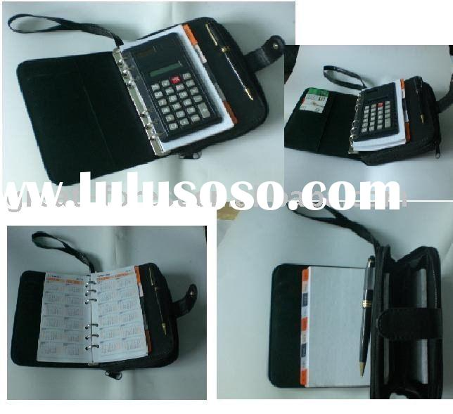 Note book with calculator and card holder