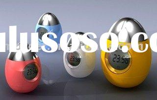 Egg shape digital alarm clock with calendar and temperature display