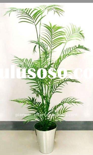 Small artificial palm tree on galvanized pot for home decoration