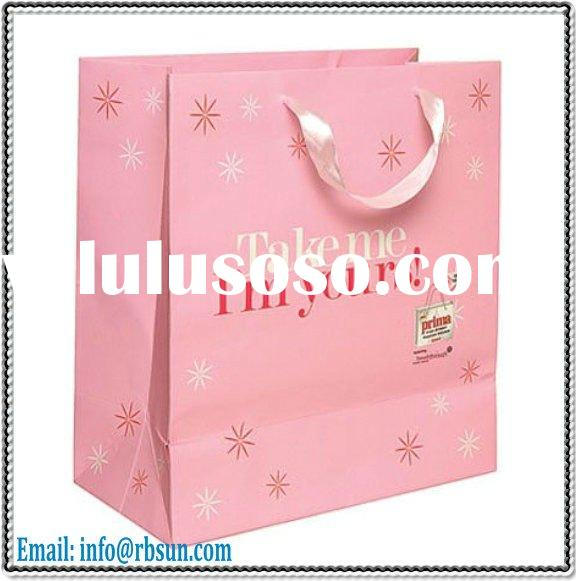 pink coated paper gift bag with pink ribbon handle