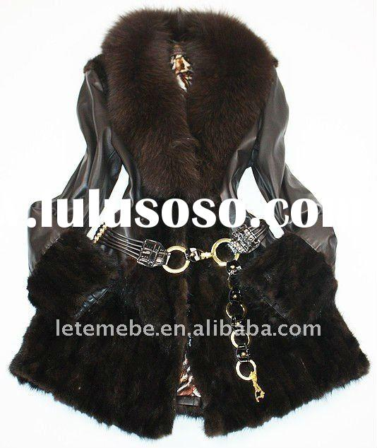 Long sheep skin coat with fox collar and mink fur sleeves