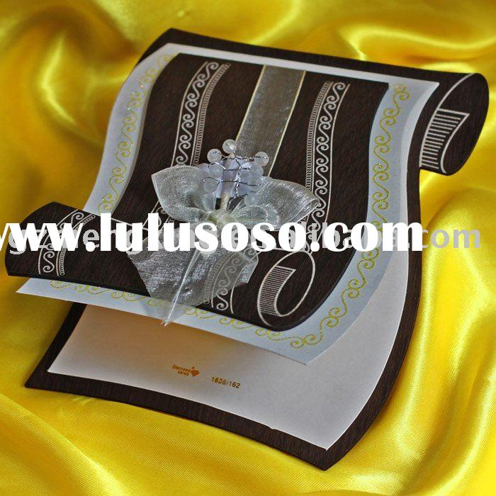 wedding invitation card with a scroll paper outlook carving fancy patterns and attaching a nice ribb