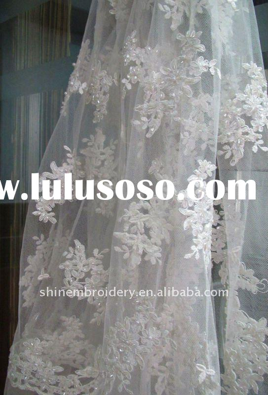 white wedding fabric with handwork embroidery designs