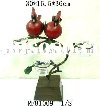 Metal votive holder with red bird on the tree design as Christmas decoration