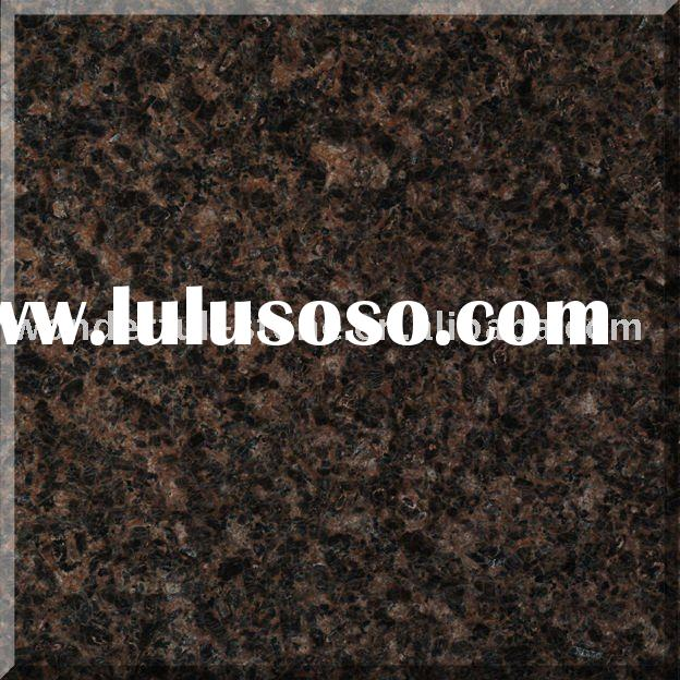 camel brown granite (tile,counter,kitchen,floor,dyed stone,slab,wall,gardens,interior and exterior)