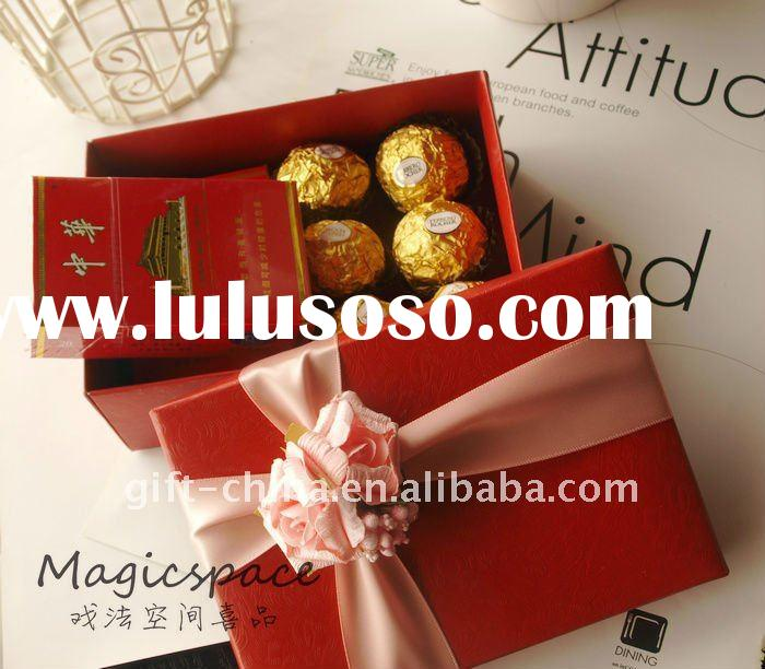 red wedding gift boxes with rose ribbon
