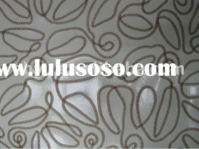 leather embroidery fabric decorated by coiled embroidery patterns