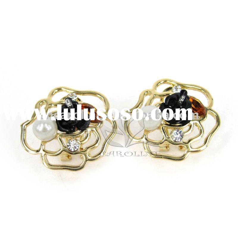 Caroline New Design gold jhumka earrings