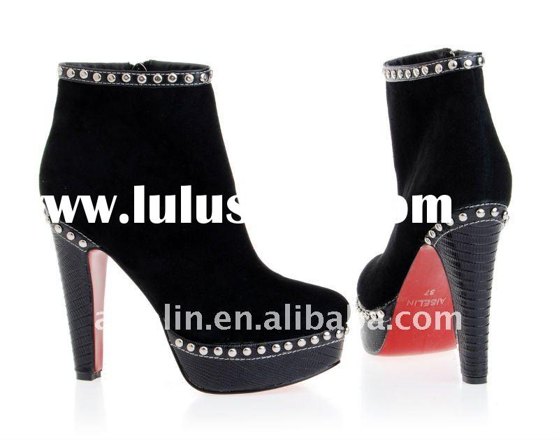 red bottom high heel boots with platform and sliver studs