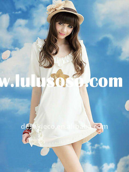 angel girls white t-shirt dress with purfle on neck and sleeves and golden star sequin on front
