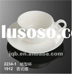 white ceramic coffee cup and saucer