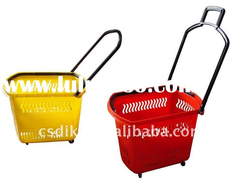 red supermarket plastic shopping basket with wheels