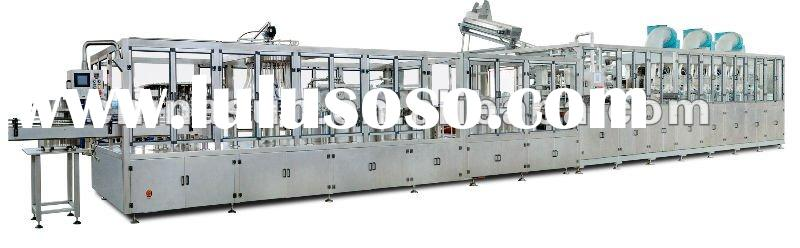 Plastic bottle blowing, filling and sealing monoblock machine
