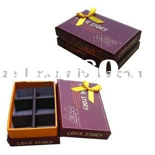 unique paper chocolate boxes with yellow ribbon.