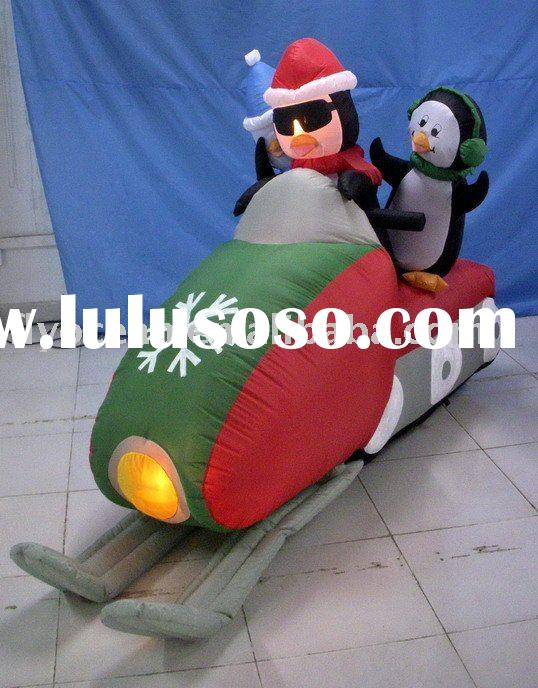 Christmas inflatable penguins driving a motor
