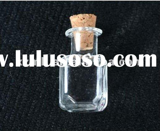 Blowing mini glass bottle with cork