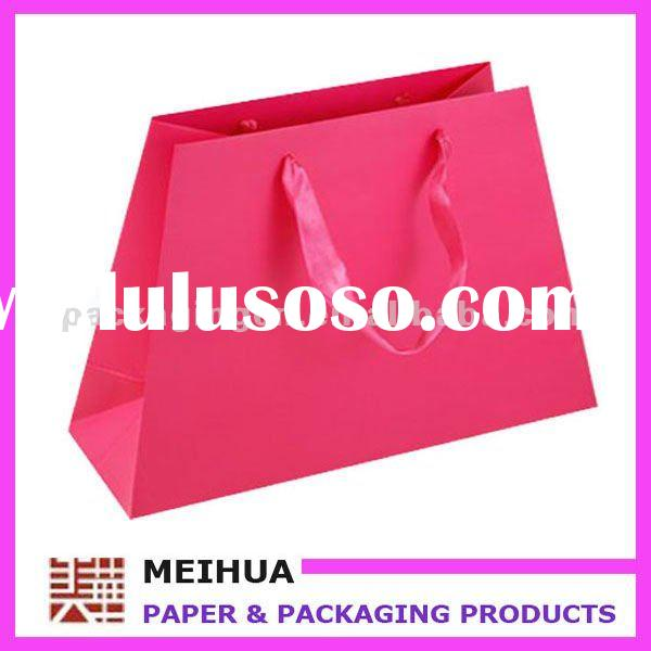 Glossy laminated hot pink paper bags with ribbon handle