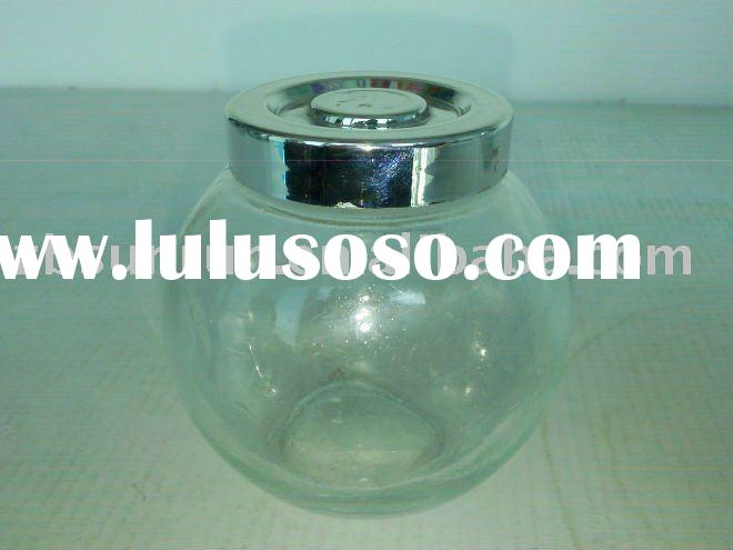 small round glass bottle with electroplate lid